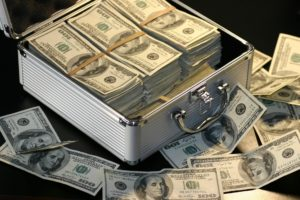 Many dollar bills in a case