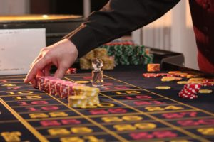 A Croupier in action at a live roulette table