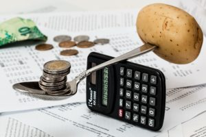 Balancing coins and a potato on a calculator