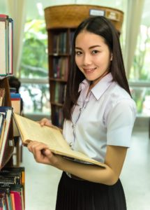 A female student in a library