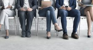 Potential employees waiting for an interview