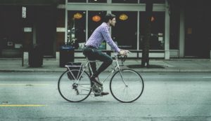 A man cycling in a city
