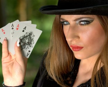 A girl holding playing cards