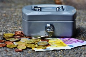 A cash box and coins