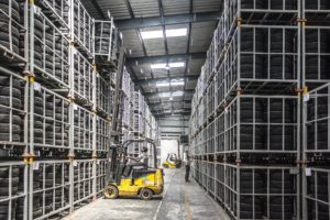 sing a forklift to manage pallets in a warehouse