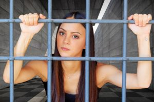 A girl behind bars
